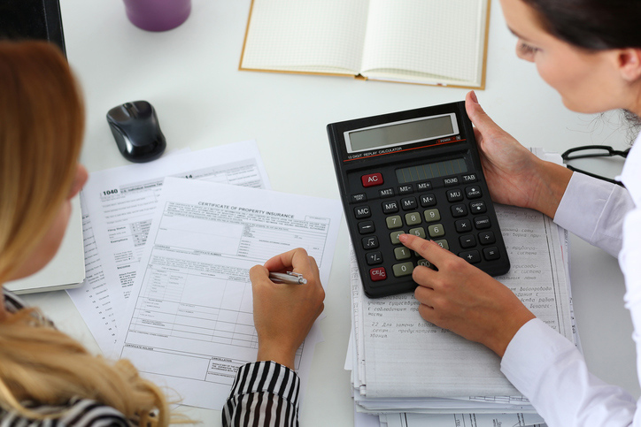 Accountant going over tax accuracy with client to avoid an IRS audit