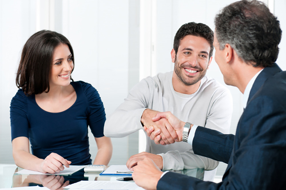 Couple partnering with a trained tax lawyer or tax relief firm